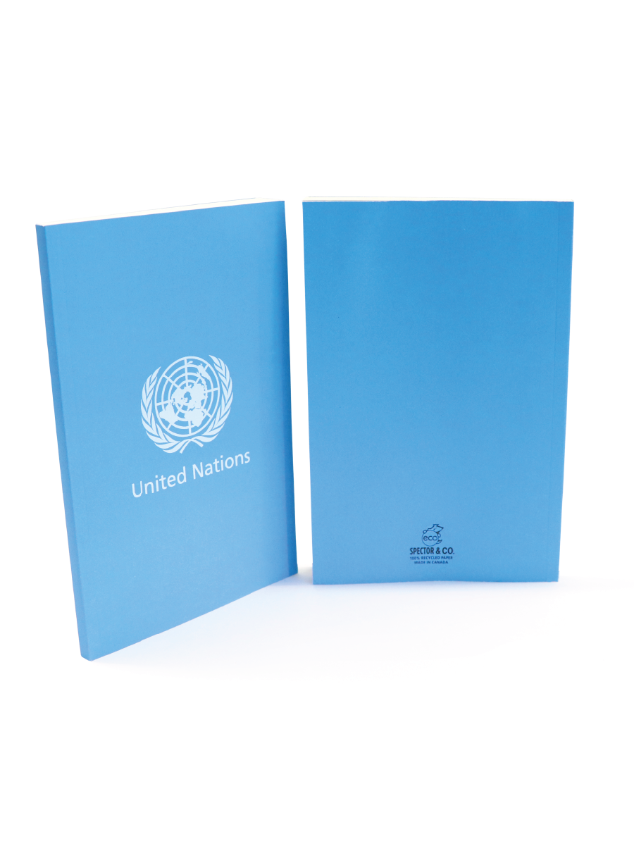 An image of a light blue, paper notebook bearing the UN Emblem and the words United Nations printed on the middle of the cover.