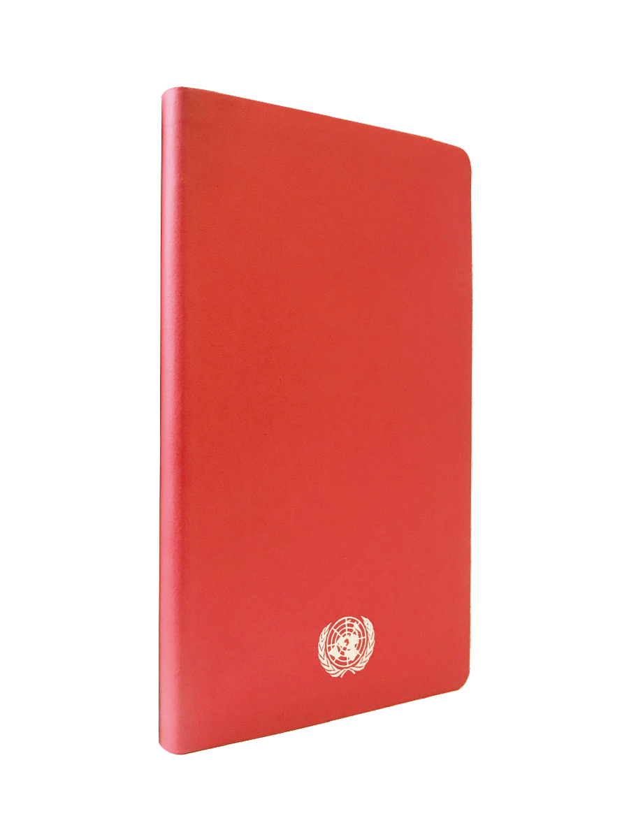 An image of a medium sized, recycled leather, red coloured journal with the UN Emblem embossed in silver centered at the bottom.