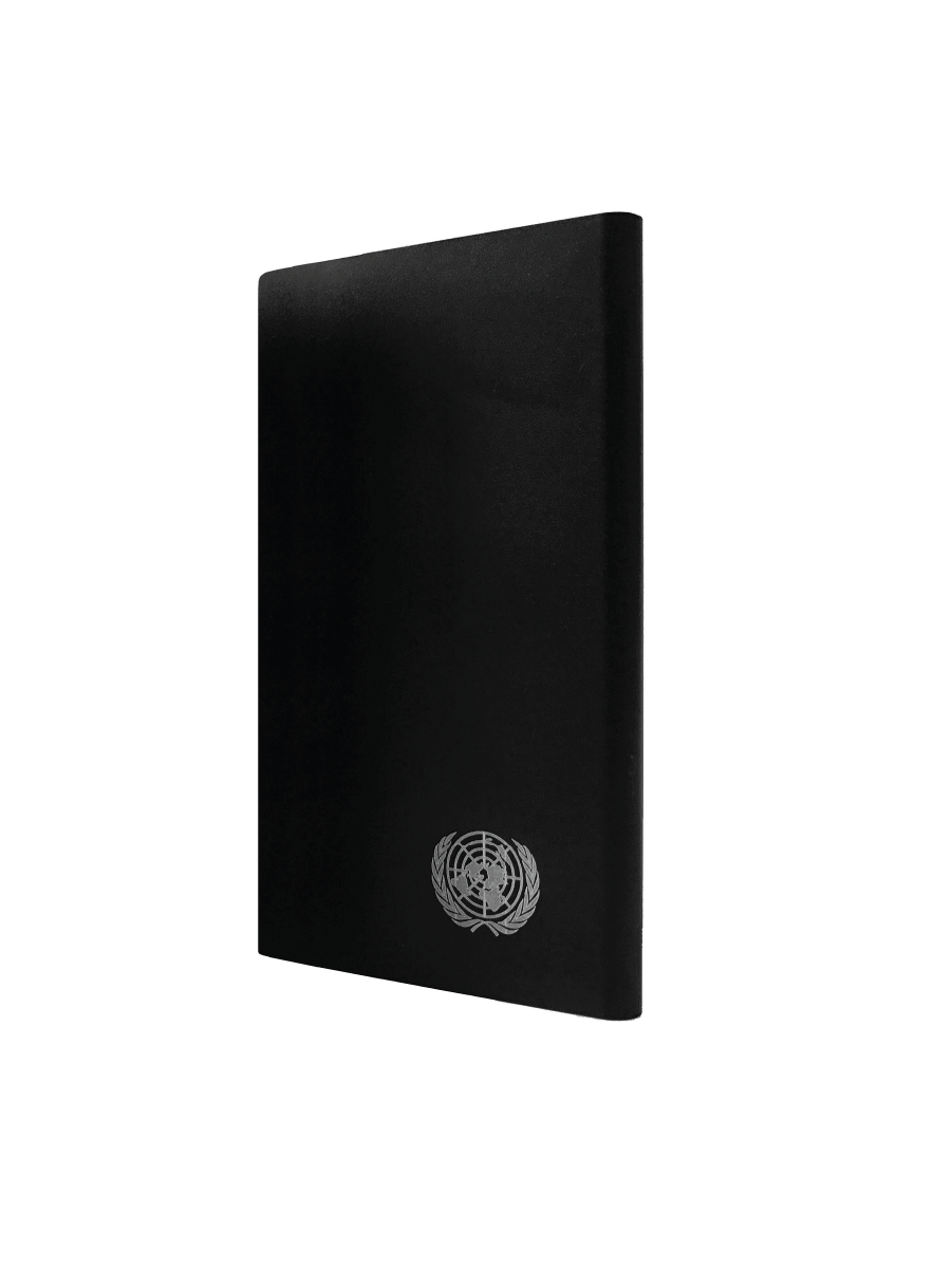 An image of a stylish portable black coloured power bank with a silver UN Emblem at bottom right. Rechargeable 4000 mAH battery with LED power status indicator.