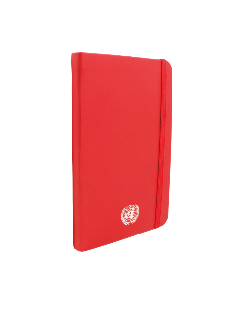 An image of a small sized, recycled leather, red coloured journal with the UN Emblem embossed in silver centered at the bottom.