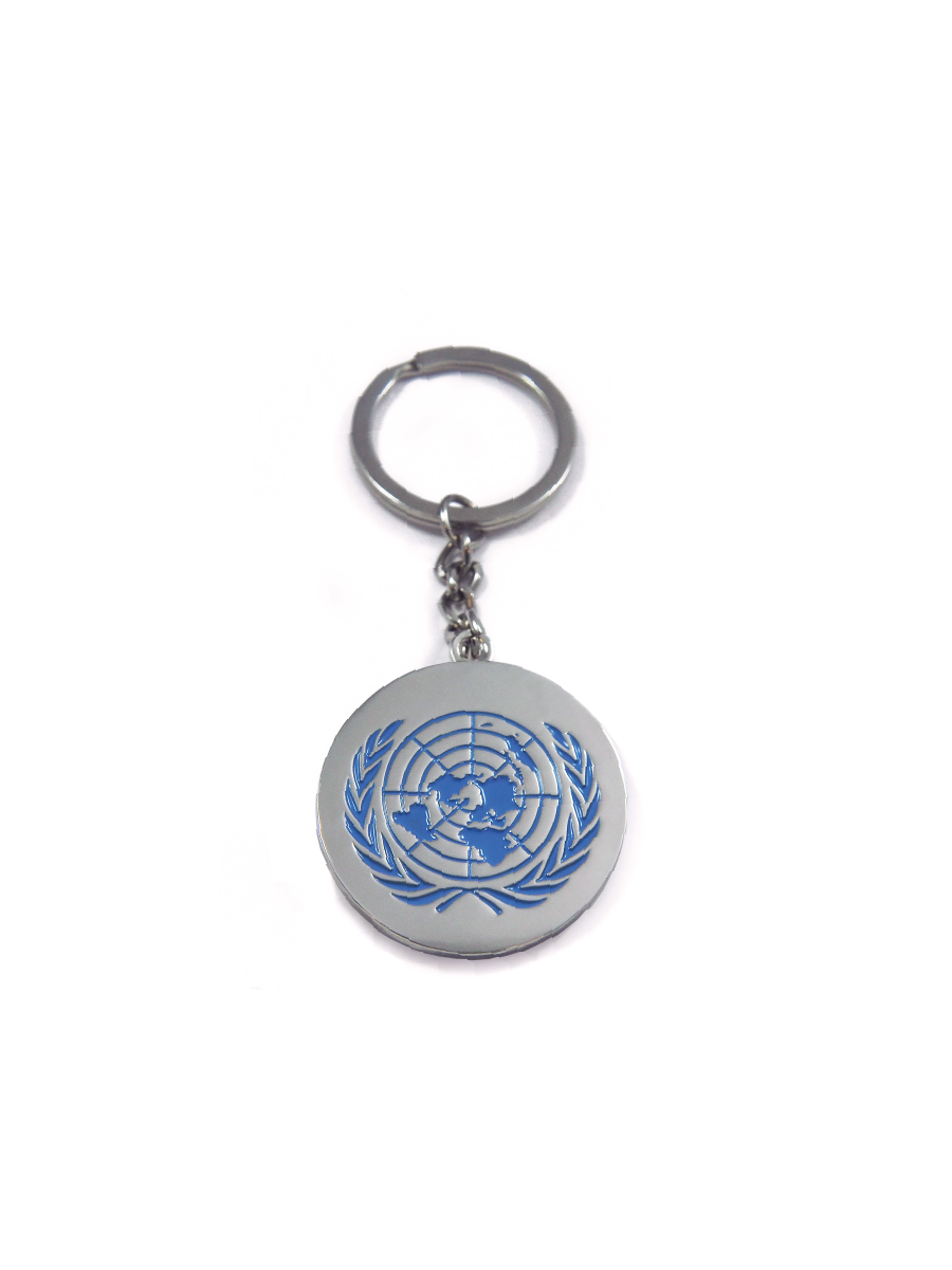 An image of a circular,silver metalkeychain with the UN Emblem etched and painted blue on the surface.