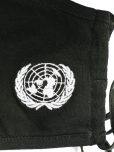 An image of a black soft triple layered organic cotton mask with a pocket to add filter. Adjustable ear straps. UN Emblem embroidered in white. Washable, reusable, and eco-friendly.