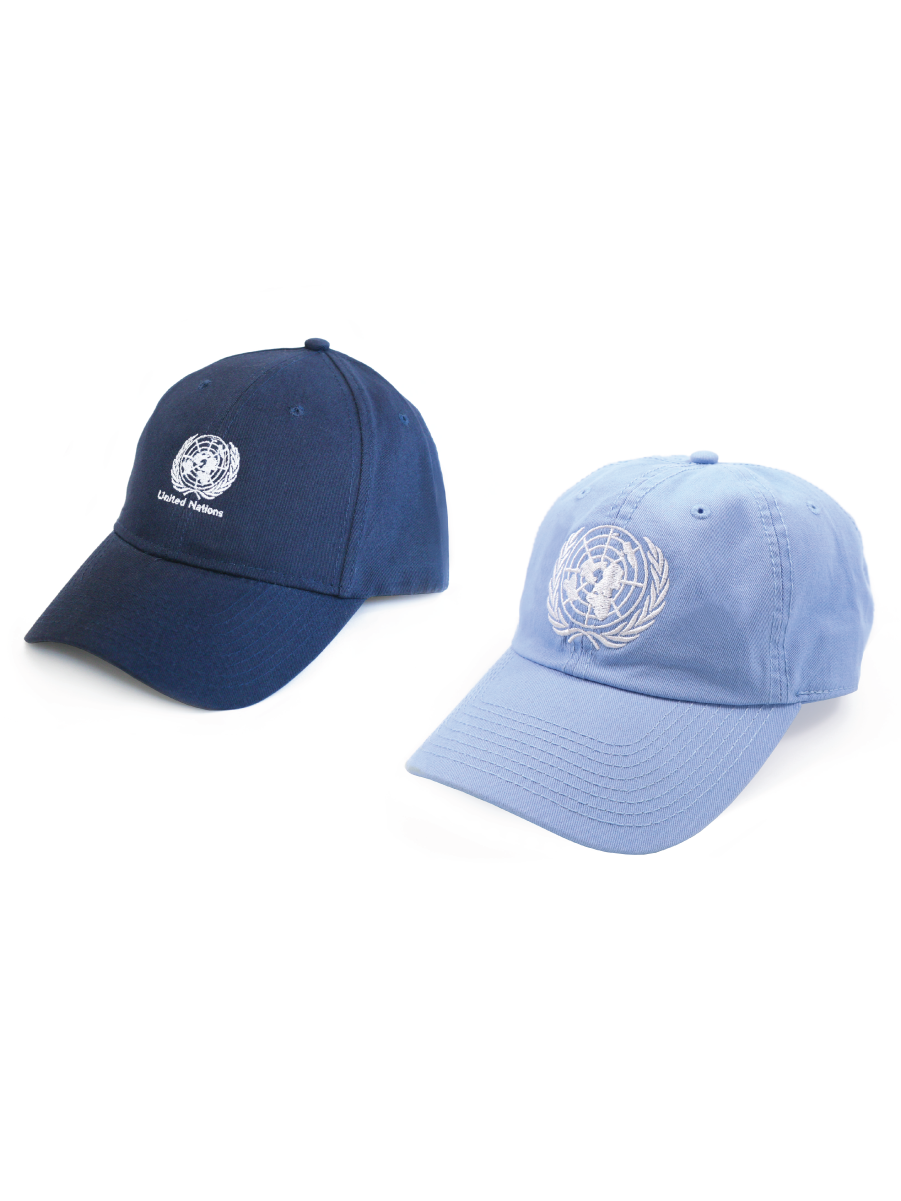 A picture of a navy blue and light blue hat with an embroidered UN Emblem.
