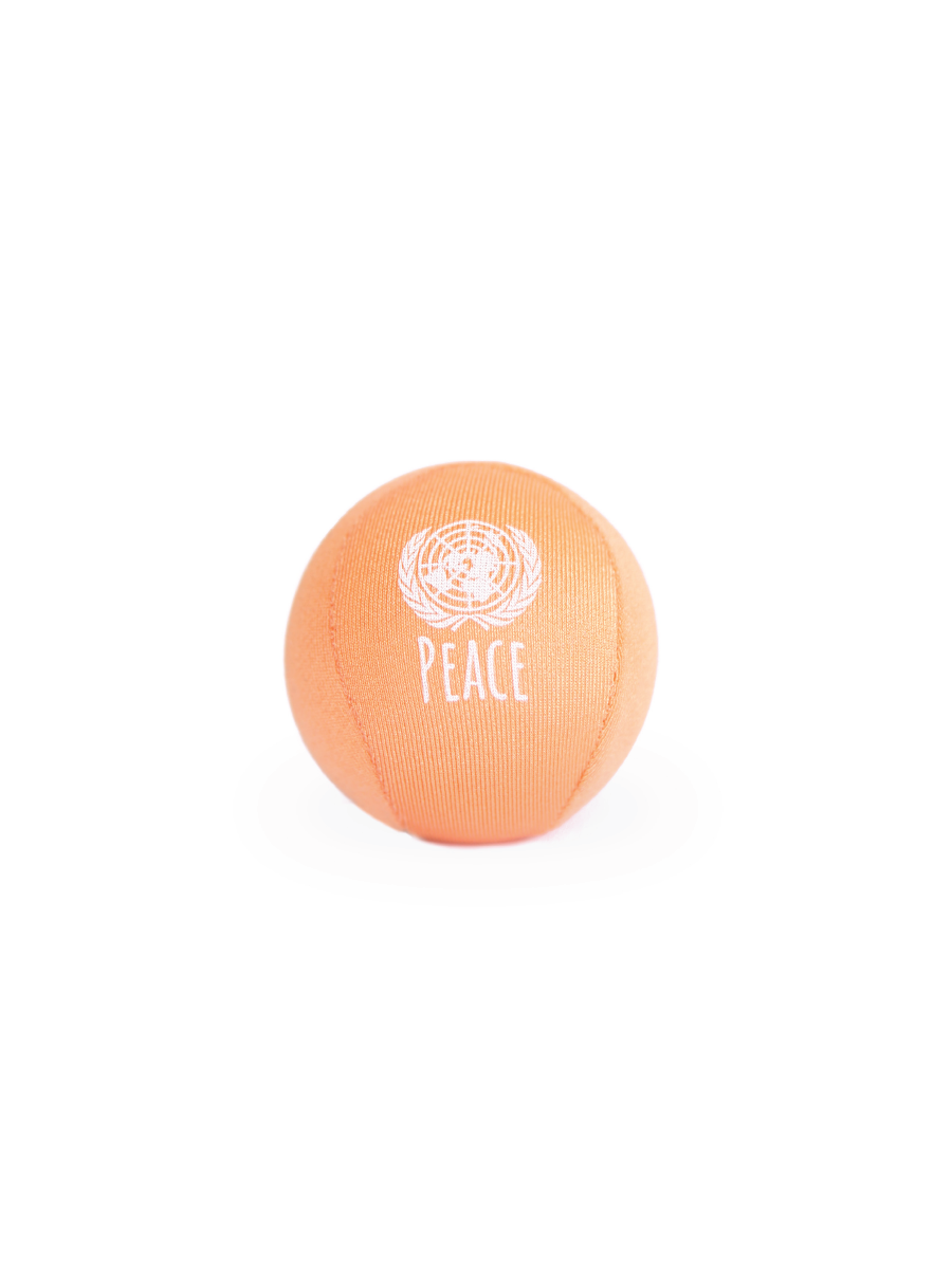 A picture of a lycra covered, squishy stress ball in orange.