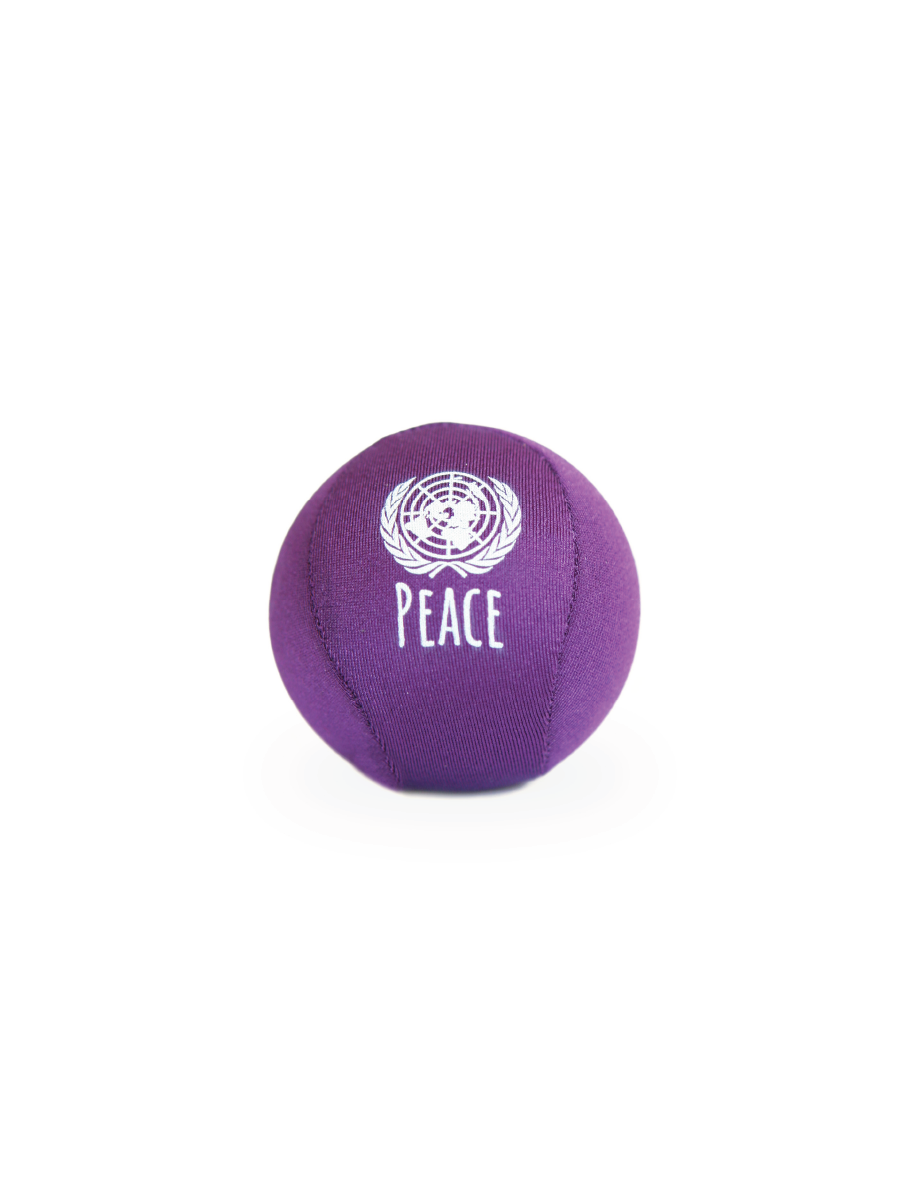 A picture of a lycra covered, squishy stress ball in purple.